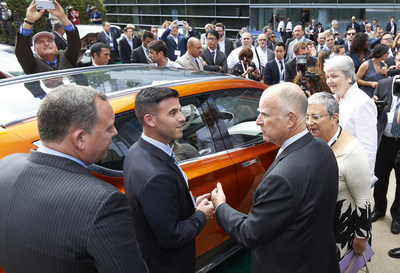 Governor Brown views Chevy BOLT concept car at DRIVE THE DREAM 2015, Photo Credit: Claudia Wong