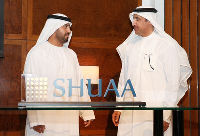 HH Sheikh Maktoum bin Hasher Al Maktoum and HE Mohammed Al Shaibani, Director General of the Dubai Ruler's Court unveils SHUAA's new logo