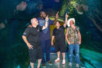 Basketball legend Shaquille O'Neal, and Animal Planet's Tanked stars, Wayde King, Brett Raymer and Redneck, visited SEA LIFE Orlando Aquarium to film the season finale of the hit series. Before finalizing the design for a new tank in Shaq's Orlando home, the group explored SEA LIFE Orlando's 360-degree walkthrough ocean tunnel, Stingray Cove and other habitats to find inspiration within Orlando's newest aquarium. Courtesy of SEA LIFE Orlando Aquarium.