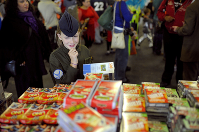 Elena, whose father Master Sergeant Paul Shideler serves the US Air Forces in Europe, selects a game at the Toy Industry Foundation and Boys & Girls Clubs Military Services toy distribution at Ramstein Airforce Base in Germany.  (PRNewsFoto/Toy Industry Foundation, David Bergman)