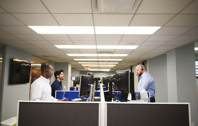 """Bankers Healthcare Group's new 6,500 square-foot suite includes two executive offices, a boardroom, conference room, full cafeteria, employee lounge and an open """"bullpen"""" floor with more than 30 workstations positioned in groups of six and eight by department."""