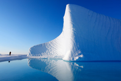 A pristine iceberg stands out starkly against Nunavut's blue skies. (PRNewsFoto/National Geographic)