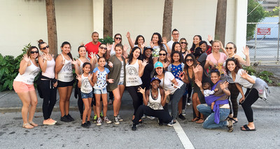 Bankers Healthcare Group employees and their families volunteer to feed the homeless in downtown Miami, Florida.