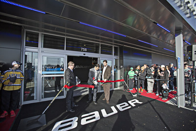 Amir Rosenthal, President of PSG Brands, cuts the ribbon at the grand opening of the BAUER OWN THE MOMENT Hockey Experience with Matt Smith, Vice President of Marketing for Bauer Hockey (left) and John Mullins, Bauer Hockey's Head of Retail (right).