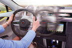 TRW is unveiling a new steering wheel concept that is being shown on the Rinspeed XchangE showcar today at the Geneva auto show. The steering wheel offers a number of multi-functional features including hands on/off detection to help support the driver during semi-automated and automated driving situations.  (PRNewsFoto/TRW Automotive Holdings Corp.)