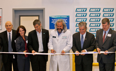 Harvey Kamil, Vice Chairman of NBTY; Andrea Lohneiss, Regional Director of Empire State Development; Jeff Nagel, CEO of NBTY; Joe Pizzo, Manufacturing Facility Director; Steve Bellone, Suffolk County Executive; Rich Schaffer, Babylon Town Supervisor cut ribbon at new NBTY Manufacturing Facility.  (PRNewsFoto/NBTY)