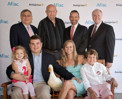 Aflac today honored the Teal Family (seated), Dr. Kevin McRedmond (r) and Harold Bessent with their Aflac DuckPrints award at Palmetto Health Children's Hospital in Columbia, S.C. Awardees are heroes in the fight against childhood cancer.