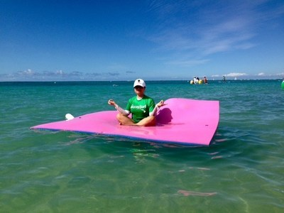 A Wounded Warrior Project Alumna enjoys the surf in Hale Koa.