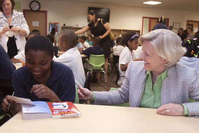 Kyle Zimmer, president and CEO of First Book, chats with a student in Alabama. Today the Ms. Foundation for Women will honor Zimmer with the 2016 Peggy Charren/Free to Be Award, provided to individuals in media whose work contributes to breaking through gender and racial lines.