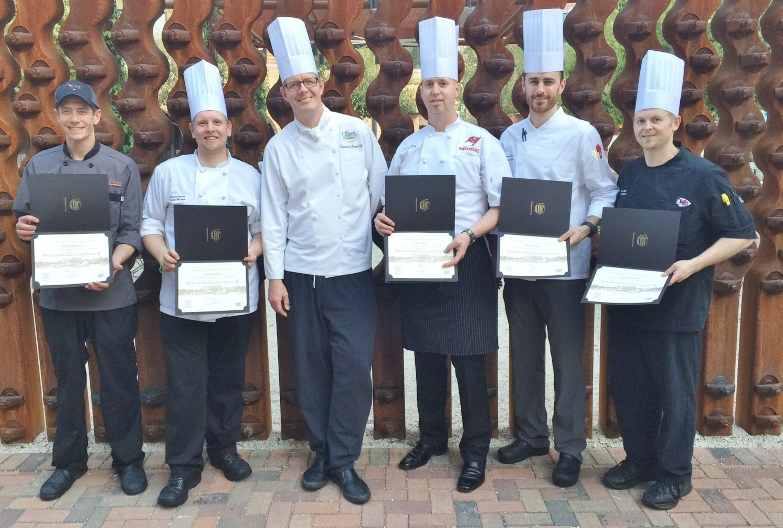 Aramark and The Culinary Institute of America are pleased to announce the graduation of 29 chefs from the prestigious ProChef(R) Certification program. The Aramark chefs pictured here serve stadiums, arenas, convention centers and entertainment venues across the United States and Canada, and join the more than 200 Aramark chefs who have already received their ProChef certification.