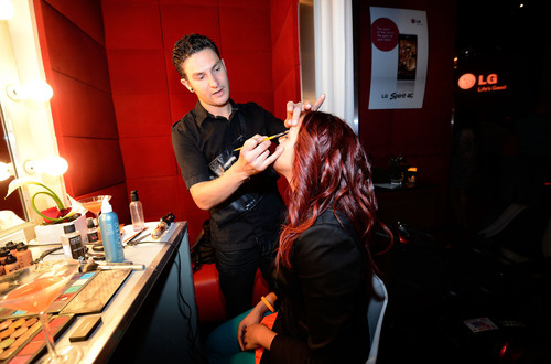 A CTIA guest receives a makeup touch-up at the Recharge, Refresh & Remix with LG Event at PURE Nightclub on ...