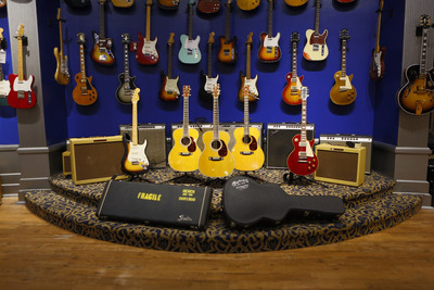 """Guitar Center Presents The Eric Clapton Crossroads Guitar Collection Featuring Five Limited Edition Signature and Replica Guitars. Guitars photographed from left to right: Fender Custom Shop Eric Clapton """"Brownie"""" Tribute Stratocaster, Martin 000-45EC """"Crossroads"""" Madagascar Rosewood, Martin 000-45EC """"Crossroads"""" Brazilian Rosewood, Martin 000-28EC """"Crossroads"""" Madagascar Rosewood, and Gibson Harrison-Clapton """"Lucy"""" Les Paul.  (PRNewsFoto/Guitar Center)"""