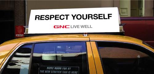 GNC Taxi Top. (PRNewsFoto/GNC Holdings, Inc., Peter Arnell) (PRNewsFoto/GNC HOLDINGS, INC.)