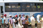 Local residents are standing in line to get on the buses provided by Sae-A to be transported to medical service place.