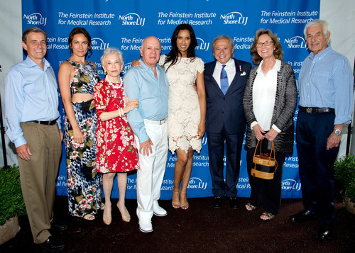 Attendees of the Feinstein Institute Summer Concert Benefit; Dr. Kevin J. Tracey, Laura Benanti, Mr. & Mrs. Feinstein, Padma Lakshmi, Dr. Tamer Seckin, Mrs. and Mr. Zucker. (PRNewsFoto/Feinstein Institute for Medical.)