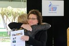 Cancer patient and Phoenix school teacher Christine Nelson receives hug from ACS CAN Grassroots Manager Alyss Jensby at Arizona Cancer Awareness Day.