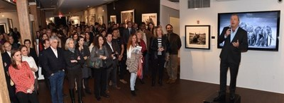 David Yarrow speaks to guest at Tusk/Yarrow Reception at Rotella Gallery in NYC