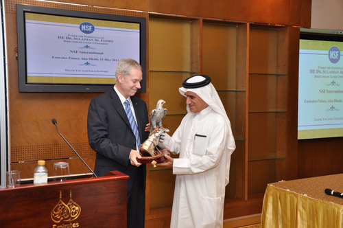Mr. Kevan P. Lawlor, President and Chief Executive Officer of NSF International, presents a gift to Dr. Sulaiman Al Jassim, Vice President, Zayed University, at a reception honoring the grand opening of NSF Middle East which was held recently at the Emirates Palace. (PRNewsFoto/NSF International) (PRNewsFoto/NSF INTERNATIONAL)