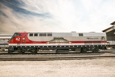 Amtrak painted a locomotive with a special design to commemorate the 50th anniversary of the Vietnam War and honor those that have served. America's Railroad has also set a goal of 25 percent of new hires to be veterans by 2015.  (PRNewsFoto/Amtrak)