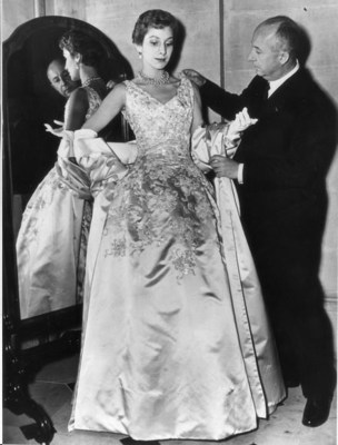 Christian Dior with model wearing one of his gowns.