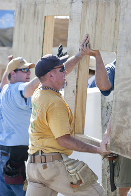 LEOGANE, HAITI (11-7-2011) -- Country music superstar Garth Brooks helps move a wall into place during Habitat for Humanity's 2011 Jimmy & Rosalynn Carter Work Project in the Santo community in Haiti. Habitat volunteers are building 100 houses here this week. (c) Gregg Pachkowski/Habitat for Humanity.  (PRNewsFoto/Habitat for Humanity International)