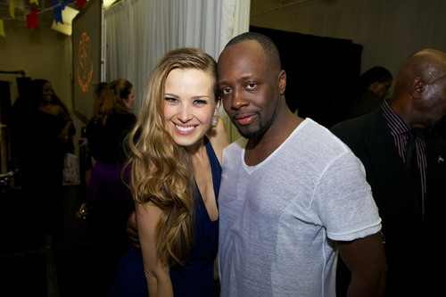 Petra Nemcova, Founder and Chairwoman, Happy Hearts Fund and evening performer Wyclef Jean celebrate in the ...