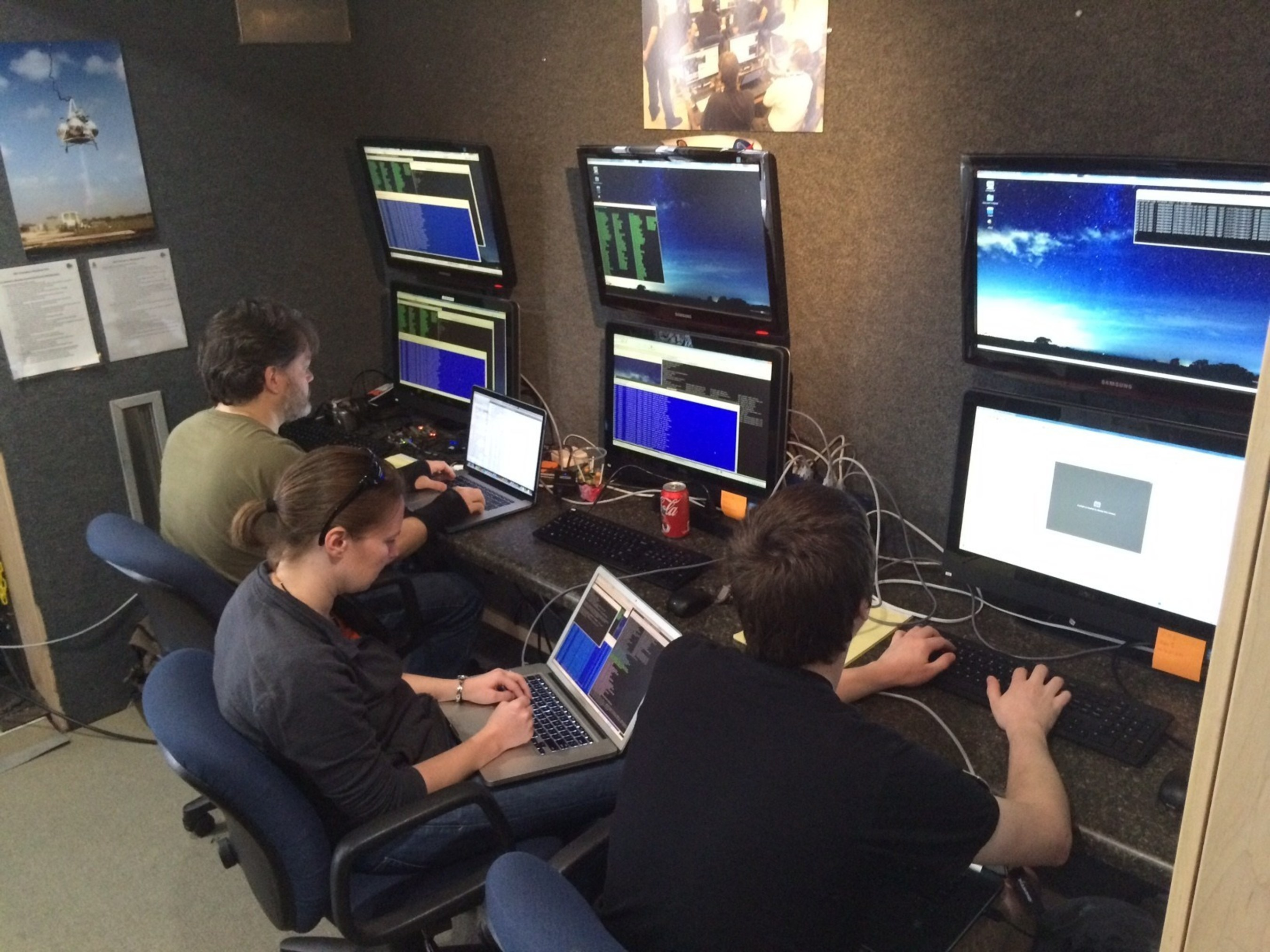 Moon Express engineers controlling the flight tests from a Mobile Mission Control Center (MMCC) located at the Kennedy Space Center Shuttle Landing Facility