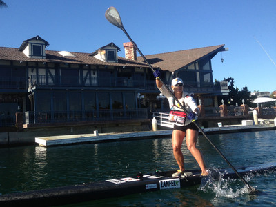"""Robyn Benincasa set a new Guinness World Record for """"Greatest Distance by Stand Up Paddleboard (SUP) on flat water in 24 hours"""" on November 8, 2013 in Huntington Beach Harbor, CA. Benincasa founded Project Athena, a non-profit that helps women with serious medical setbacks capture their dreams of physical adventure.(PRNewsFoto/Project Athena Foundation)"""