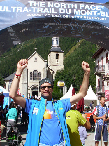 Bob Weinhold, of Doylestown, Pa., celebrates after completing The North Face Ultra-Trail du Mont-Blanc ...