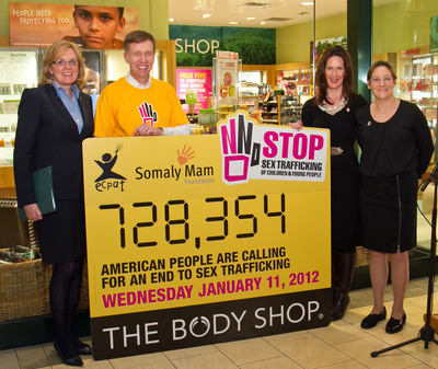 The Body Shop, together with NGO partners ECPAT USA and the Somaly Mam Foundation hand over more than 720,000 signed American petition signatures, calling for an end to the sex trafficking of children and young people, to the President of the National Association of Attorneys General, AG Rob McKenna on National Human Trafficking Awareness Day.  (PRNewsFoto/The Body Shop)