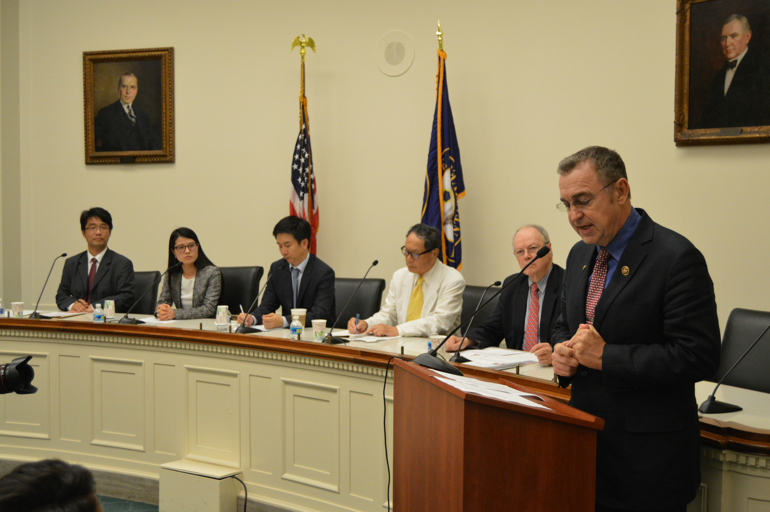 """U.S. Rep. Matt Salmon (R-AZ), chairman of the House Asia and the Pacific Subcommittee and congressional co-host of the briefing, welcomes panelists who spoke on human rights issues in North Korea, the role of information technology, and support for unification of the Korean Peninsula. From left, Mr. Yon-ho Kim, Senior Researcher, US-Korea Institute at SAIS, Ms. Grace Jo, North Korean Defector and Vice President of NKinUSA, Mr. Cheol Hwan Kang, North Korean Defector, Co-President of Action for Korea United, and Author of """"Aquariums of Pyongyang,"""" Mr. Tong Kim, former SAIS professor, and Mr. Michael Marshall, Editor Emeritus of UPI and Senior Research Advisor at Global Peace Foundation."""
