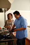 Iron Chef Jose Garces at home with his BlueStar restaurant-quality gas cooking equipment for the home.  (PRNewsFoto/BlueStar, Jason Varney)