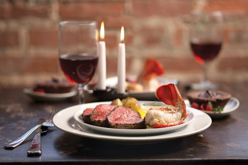 When it comes to Valentine's Day, the majority of Americans would enjoy a romantic dinner for two at home with steak and lobster as top choices for what's on the menu.  (PRNewsFoto/Omaha Steaks)