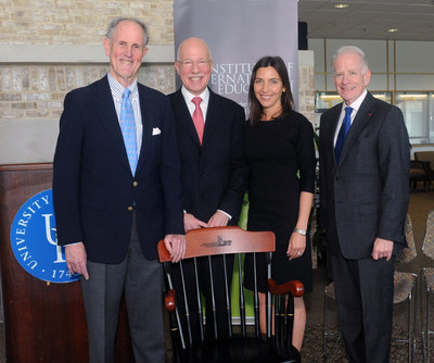 Former Delaware Sen. Ted Kaufman (far left), an IIE board member, joined the Chairman of the IIE Scholar Rescue Fund, Mr. Mark Angelson, and Dr. Allan Goodman (far right), IIE's President, to present a commemorative chair to Biden's widow, Hallie Biden.