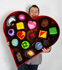 Artist Peter Anton holding his boxed chocolates sculpture.