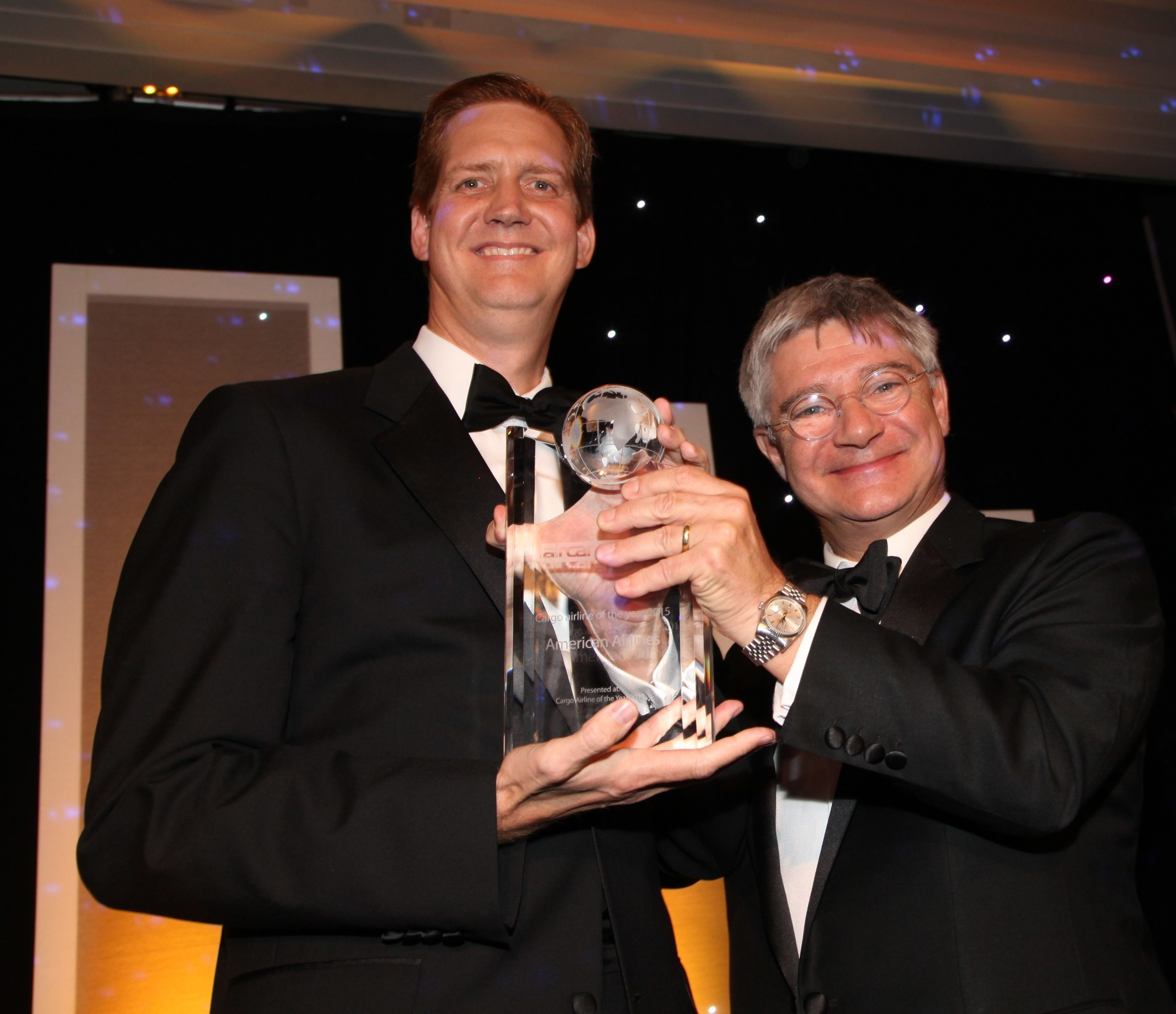 Jim Butler, president of American Airlines Cargo, accepts the Cargo Airline of the Year award from Mark Whitehead, CEO, Hactl