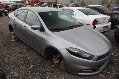 Cars up on blocks, missing their tires and rims, are a frequent sight in the Detroit area.