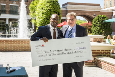 Pedro Cherry, senior vice president of Georgia Power's Metro Atlanta region, presents a rebate check for $71,500 to Post Properties CEO and President Dave Stockert.