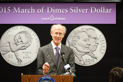 Dr. Peter Salk reveals the March of Dimes Silver Dollar featuring his father, Dr. Jonas Salk. Coins can be purchased at http://1.usa.gov/1MoGVwF . (photo March of Dimes Foundation)