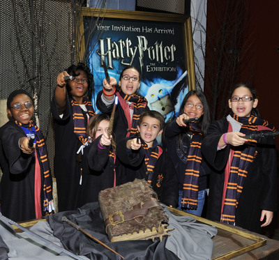 Excited New York City children celebrate Harry Potter: The Exhibition making its final North American tour stop at Discovery Times Square in New York City on April 5, 2011.    (PRNewsFoto/Discovery Times Square)