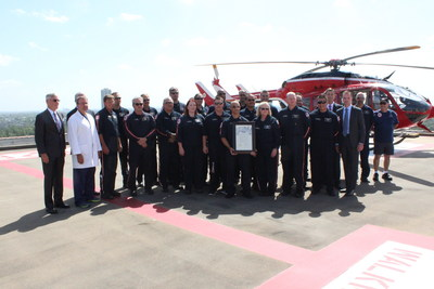 Members of the Memorial Hermann Life Flight crew gather on the John S. Dunn Heliport at Memorial Hermann-Texas Medical Center to celebrate the program's 40th anniversary.