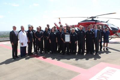 Members of the Memorial Hermann Life Flight crew gather on the John S. Dunn Heliport at Memorial Hermann-Texas Medical Center to celebrate the program's 40th anniversary.