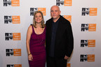 Yvette Alberdingk Thijm, executive director and WITNESS co-founder, musician, human rights advocate Peter Gabriel at the 2014 Focus For Change Benefit in New York City, October 16, 2014. Photo courtesy WITNESS, by Jenna Bascom