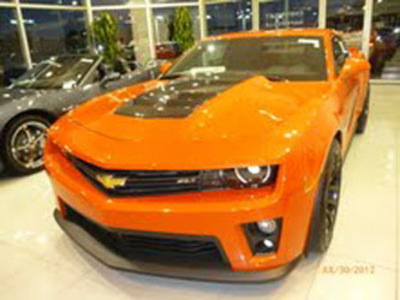 Naperville Chevy dealership, Chevrolet of Naperville, has a 2013 Camaro ZL1 in stock in the Inferno Orange Metallic color.  (PRNewsFoto/DealerFire)