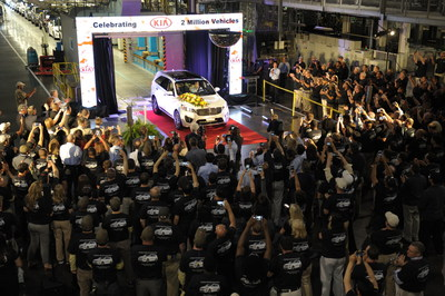 KMMG team members celebrate production of the plant's two millionth vehicle.