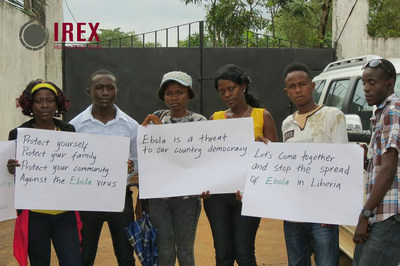 Staff from IREX partner NAYMOTE implementing Ebola awareness campaign in Liberia (PRNewsFoto/IREX)