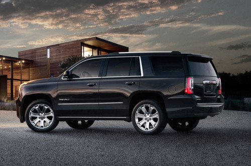 The 2015 GMC Yukon Denali is capable of producing 420 horsepower, yet still achieves 21 mpg on the highway.  (PRNewsFoto/Briggs Auto Group)