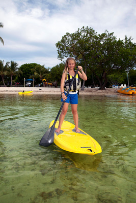 The new Lifetime Hooligan(TM) Youth Paddleboard is created specifically for ages 5 years and older so family members of all ages can enjoy the fast-growing sport of Stand-Up Paddleboarding (SUP). The compact size and lightweight design is easy to handle and maneuver both in and out of the water. In addition to its unique wider stance, the Lifetime Hooligan(TM) Youth Paddleboard provides extreme stability for beginners by incorporating a retractable fin which automatically retracts when it hits an object such as a rock or sand bar to increase stability for younger paddlers.  (PRNewsFoto/Lifetime Products, Inc.)