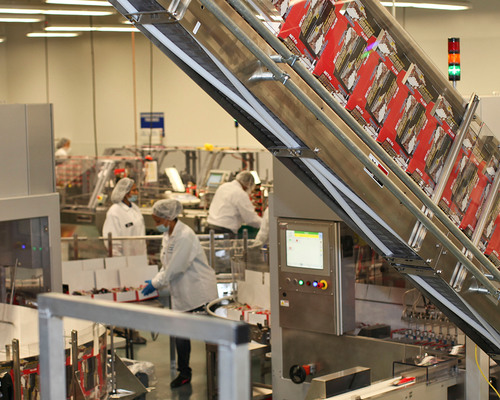 NBTY employees producing MET-Rx nutritional bars at new manufacturing facility.  (PRNewsFoto/NBTY)