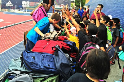 Realtor volunteers collect and distribute backpacks stuffed with school supplies to Boys & Girls Clubs youth.